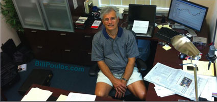 Bill Poulos at home sitting inside his Trading Lab